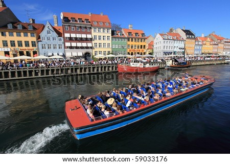 COPENHAGEN - JUNE 5: crowds gathered at Nyhavn to celebrate the anniversary of Constitution Day on June 5, 2010 in Copenhagen, Denmark.