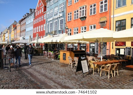 COPENHAGEN - MARCH 11: Tourists in Nyhavn street on March 11, 2011 in Copenhagen, Denmark. It is the most visited city in Nordic countries with 1.3 million annual tourists, Nyhavn its most iconic part