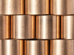 Copper alloy texture. Sleeve bronze bearings macro photo with selective focus