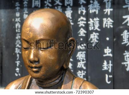 Copper Buddha near Tokyo's Senso-ji temple.