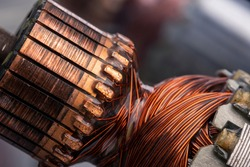 Copper commutator bar of the electric motor close up. Electric motor rotor.