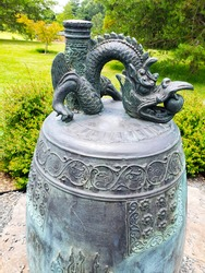 copper dragon on a Korean bell. in the park