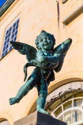 Copper green angel sculpture, little chubby child with wings