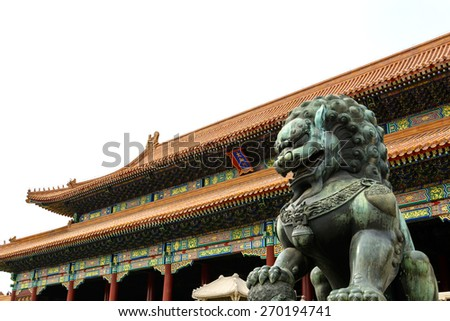 Copper lion in front of an ancient architecture in Forbidden city, Beijing China