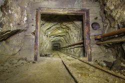 Copper mine underground tunnel with rails and door