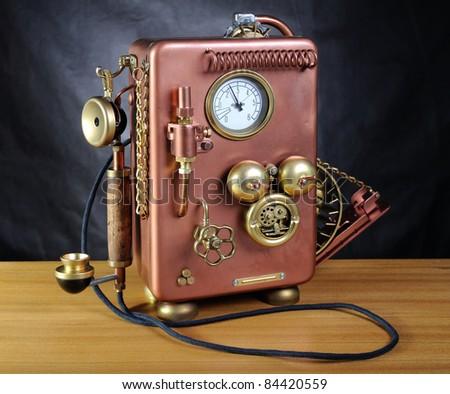 Copper phone on a dark background. Style steampunk.