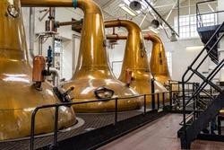Copper pot stills in a scotch distillery