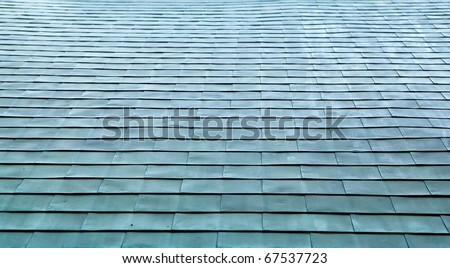 Copper roof shingles on large roof