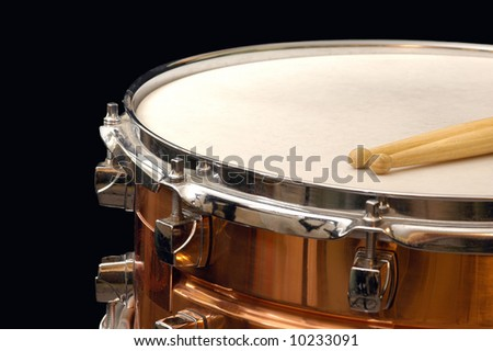 copper snare drum on black