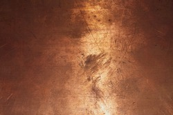 Copper surface. bronze background. metal plate with spots and scratches. brown grunge texture