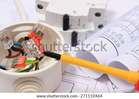 Copper wire connections in electrical box, rolls of electrical diagrams and electric fuse on construction drawing of house, accessories for engineering work, energy concept