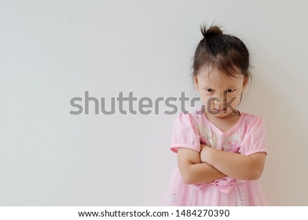 Copy space and portrait Asian girl 3 year old punished. Asia kid cross her arm and making angry face. Concept punish kid and time out limit, Rule and punishment, problem and handle, terrible two Stock photo ©