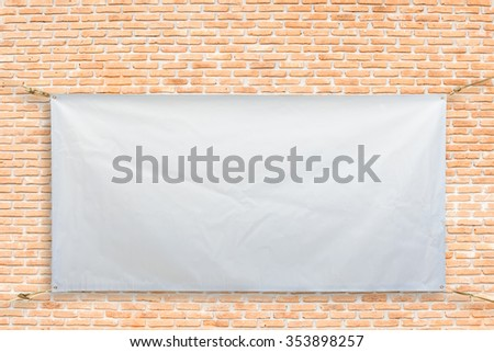 Copy space for text on disastrously white vinyl banner on brick background .Clipping path #353898257
