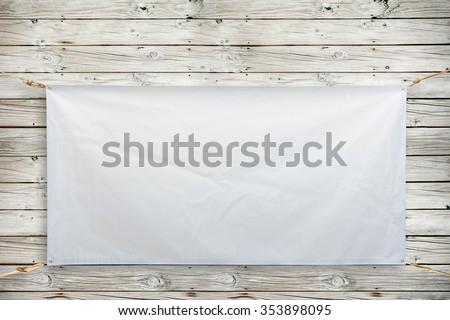 Copy space for text on disastrously white vinyl banner on wood background .Clipping path #353898095