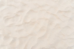 Copy space of sand beach texture abstract background. Summer vacation and travel relaxation concept. Vintage tone filter effect color style.
