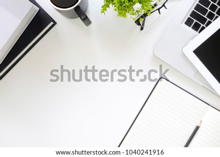 Copy space of workspace with office supplies top view table.