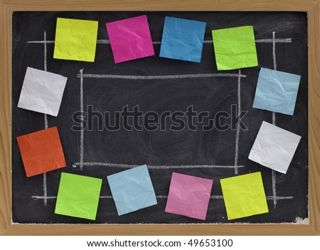 copy space on blackboard with white chalk texture surrounded by colorful blank sticky notes