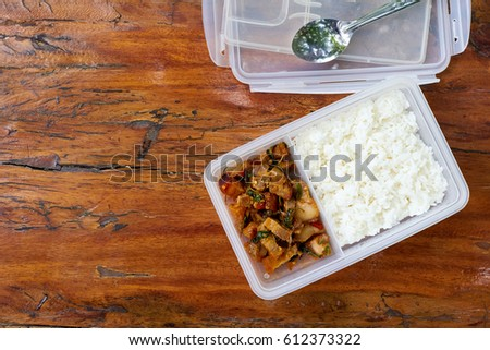 Copy Space.Packed lunch, Sack lunch, Bag lunch, Brown-bag lunch, Boxed lunch,Lunch Box.Thai Spicy Basil with Crispy Pork Belly with Rice