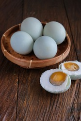 Copy space, selective focus of Telur Asin or Salted eggs is a general term for preserves made from duck eggs preserved by marinating served on bamboo plate.