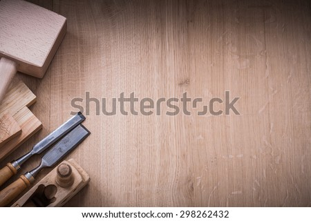 Copy space version of lump hammer planer metal chisels and wooden planks on wood board construction concept. 商業照片 ©