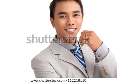 Copy-spaced isolated portrait of a smiling businessman knowing his business well