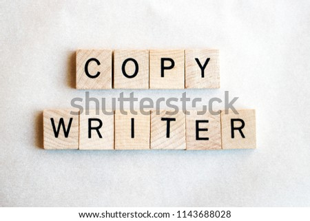 Copy writer written in square wooden blocks with black letters on a white background. Concepts of writing, author, journalism