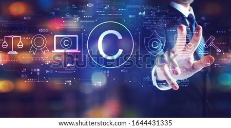 Copyright concept with businessman on night city background Сток-фото ©