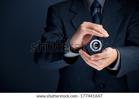 Copyright, patents and intellectual property protection law and rights. Author with protective gesture and copyright symbol.