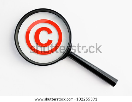 copyright symbol under a magnifying glass, with isolated background