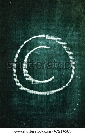 copyright symbol written with a chalk on a blackboard