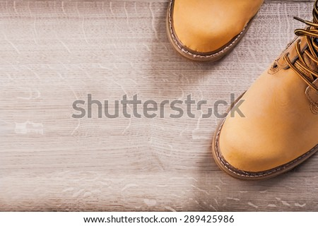 copyspace image two working boots on wood board. #289425986