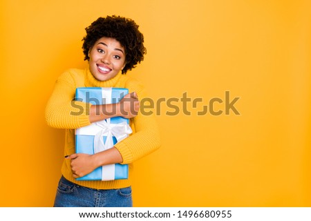 Copyspace photo of charming nice cute cheerful fascinating cheerful girlfriend hugging wrapped gift box received just while wearing jeans denim pullover isolated vivid color background #1496680955