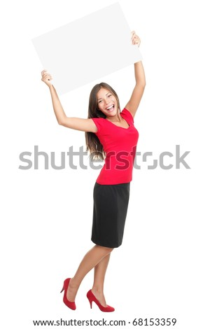 copyspace woman happy holding blank sign above her head. Beautiful young excited woman in red isolated in full length on white background.