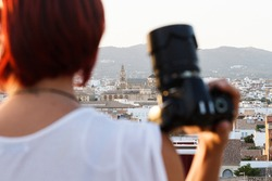 Cordoba, Andalusia, Spain and female photographer's blur taking pictures with camera