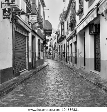 CORDOBA, SPAIN-MAY 16:View of Deanes Street, in La Juderia district, on May 16, 2012 in Cordoba, Spain. La Juderia is the most visited by tourist in the city, full of souvenir shops and restaurants