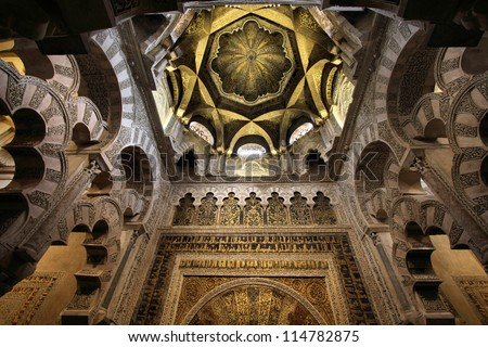 Cordoba, Spain. The Great Mosque (currently Catholic cathedral). UNESCO World Heritage Site. Mihrab interior. - stock photo