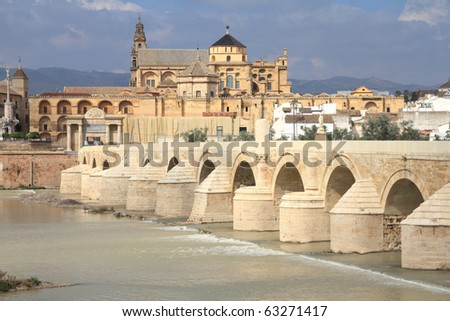 Cordoba, Spain. The Great Mosque (currently Catholic cathedral). UNESCO World Heritage Site. View with famous Roman Bridge and Guadalquivir river.
