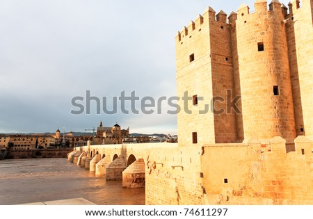 Cordoba, Spain. The Great Mosque (currently Catholic cathedral). UNESCO World Heritage Site. View with famous Roman Bridge, the calahorra Tower and Guadalquivir river.