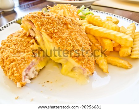 cordon bleu with french fries at a fine restaurant