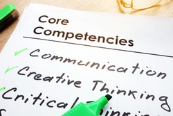 Core Competencies list on a office table.