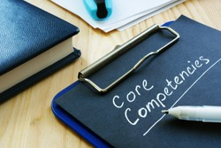 Core competencies list on the black page.
