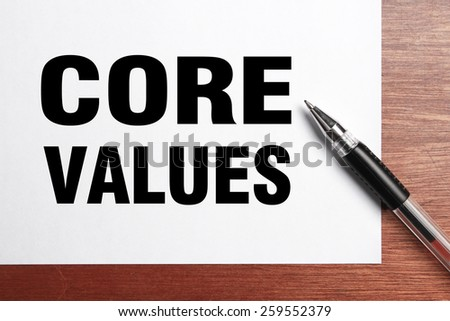 Core Values text is on white paper with black pen aside.