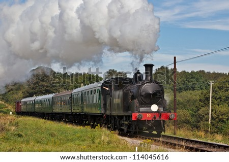CORFE, UK - SEPTEMBER 8: Ex Southern Railways tanker, number 53 approachs Corfe station during the Swanage Railway's autumn steam gala with a train full of passengers on September 8, 2012 in Corfe