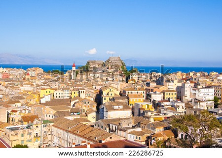 CORFU-AUGUST 22: Panoramic view of Corfu old town with the Old Fortress and the Saint Spyridon Church in the distance from the New Fortress on August 22, 2014 on Corfu island, Greece.