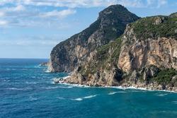 Corfu Greece tropical paradise Greek island view of massive mountain cliff and Ionian sea ocean in the town of Paleokastritsa