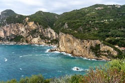 Corfu Greece tropical paradise Greek island view of remotely located ocean bay surrounded by mountain cliffs in the town Paleokastritsa