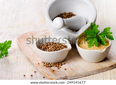 Coriander seeds, fresh coriander leaves and powdered coriander. Selective focus