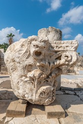 Corinthian capital bearing the carved head of a lion at Beit She`an National Park in Israel