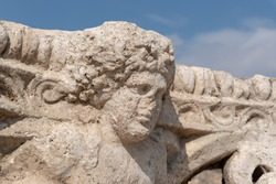Corinthian capital bearing the carved head of Dionysus at Beit She'an in Israel