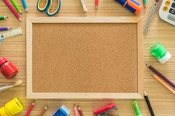 Cork board and stationery put on desk free space for text . view from above. educations concept, back to school concept.